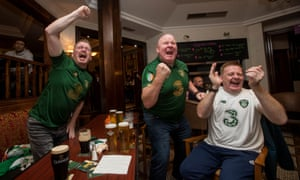 Ireland fans Andy Whelan, Patrick Hegarty and Alan Condron celebrate Shane Duffy scoring their equaliser.