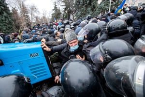 Riot police clash with farmers during a protest in Chișinău, Moldova
