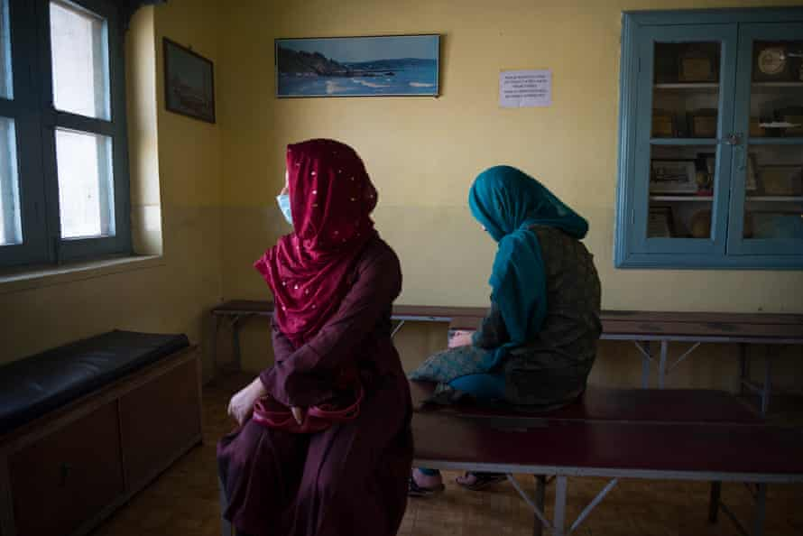 Two teenage girls sit in the waiting room of a leading Kashmiri psychiatrist in the summer capital Srinagar. Both are being treated for depression