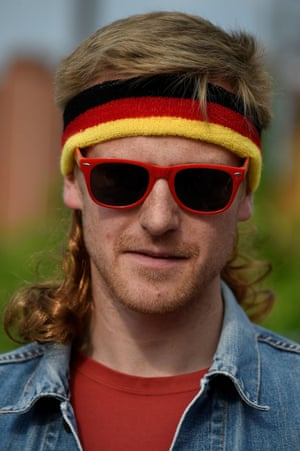 A man poses during the mullet haircut festival in Boussu, Belgium.