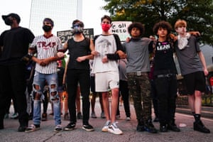 ATLANTA Protesters link arms during a demonstration