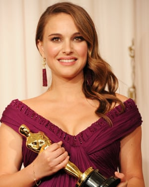 Portman accepting her Oscar for Black Swan.
