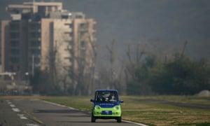 A man drives a zero polluting car in Santiago