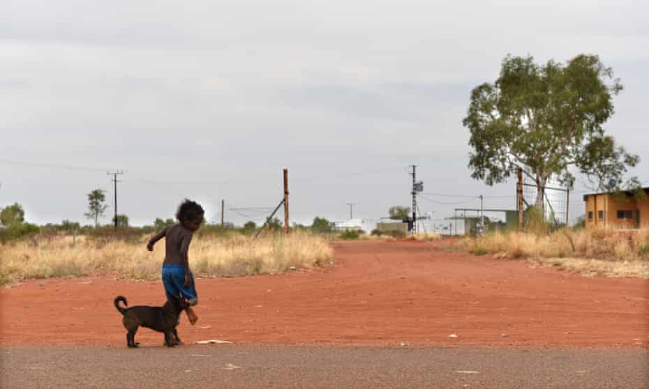 A young boy plays in an  Aboriginal community in NT