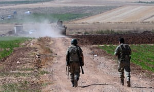 Turkish soldiers patrol near the border with Syria