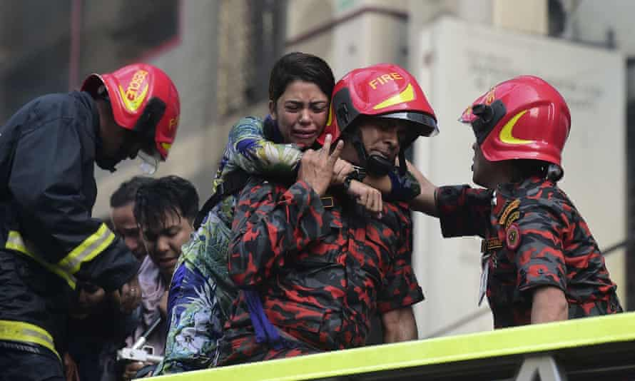 A survivor is rescued by firefighters