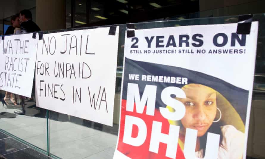 Signs supporting Yamatji woman Ms Dhu, who was jailed for unpaid fines and died in custody