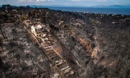 Damage caused by wildfire in the village of Mati, near Athens