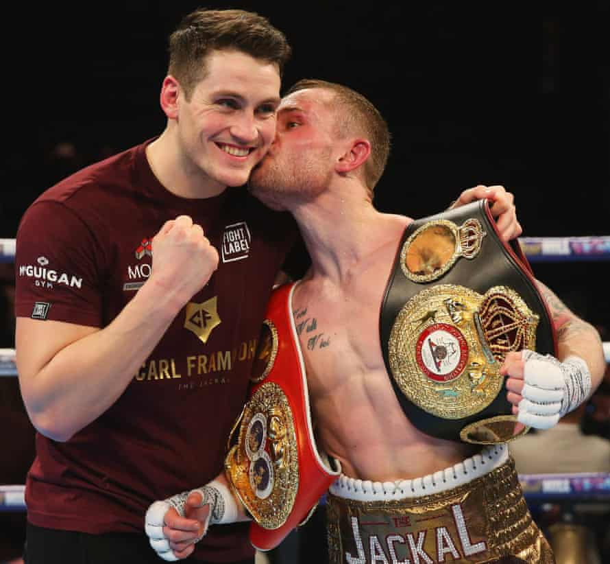 Carl Frampton kisses Shane McGuigan in celebration after a points victory over Scott Quigg in 2016.