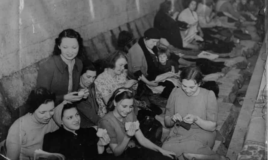 'I didn't worry abut the bombs when I had my head buried in a book' ... people sheltering, and reading, in Bethnal Green tube station during the second world war.