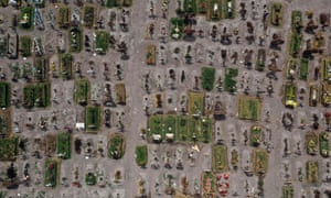 This file aerial photo taken on July 28, 2020 shows a view of graves at the special area for Covid-19 victims of the Municipal Pantheon of Valle de Chalco, State of Mexico.