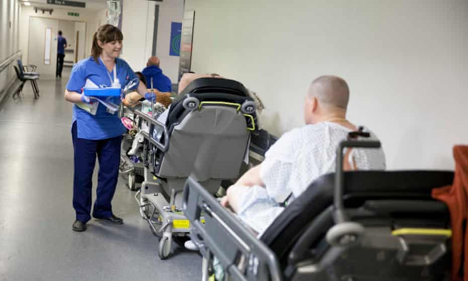 A nurse attends to patients waiting for spaces in A&E