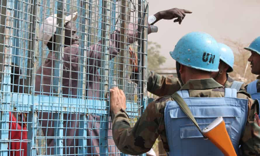 A South Sudanese civilian speaks with UN peacekeepers at the UN-administered protection of civilians camp near Malakal.