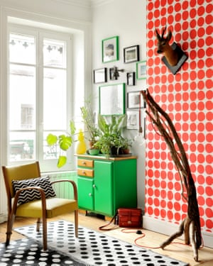 Joining the dots: vintage cabinet, home-made lamp and Marimekko wallpaper in the living room.
