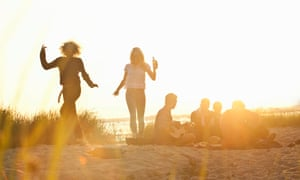 Six adult friends partying at sunset