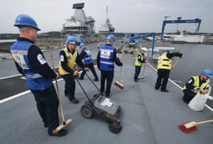Royal Navy crew sweep the deck
