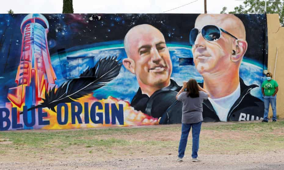 Margarita Moilina, left, and her daughter Ronnie take pictures in front of a mural dedicated to Blue Origin CEO Jeff Bezos in Van Horn, Texas.