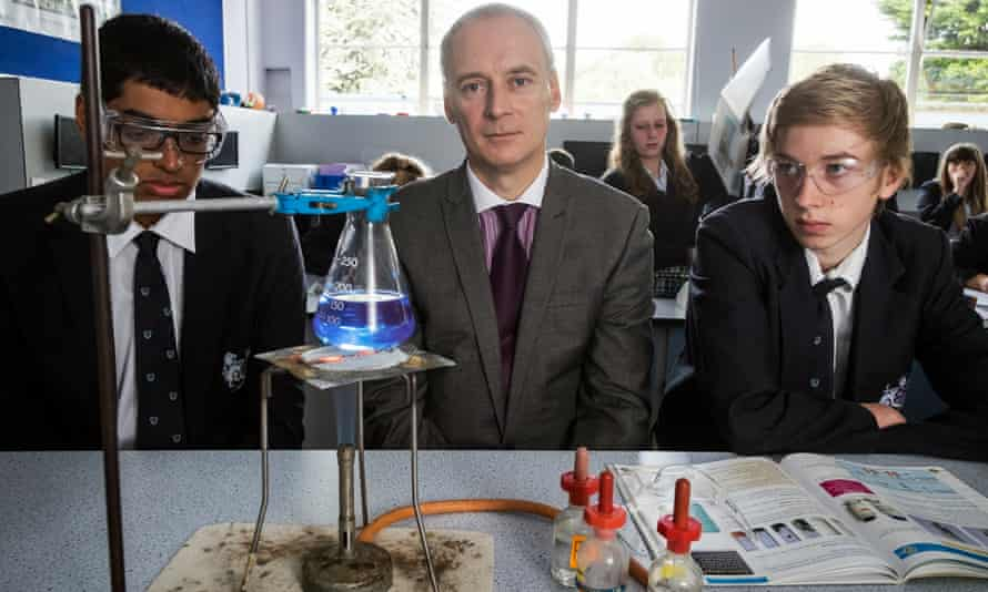 Rob McDonough with pupils in a science class