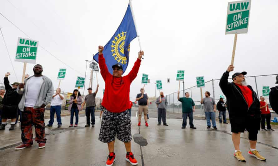 United Auto Workers (UAW) members picket at a gate at the General Motors Flint Assembly Plant on Monday.
