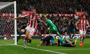 Peter Crouch celebrates after scoring from close range.