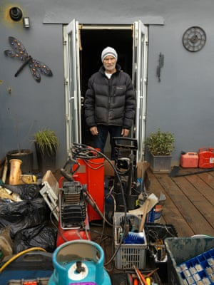 """Bart Thomson surveys his ruined belongings outside his home. """"Twenty five years ago we didn't have this problem with flooding. We don't know what the answer is."""""""