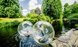 Zorbing on water at River Dart country park, UK.