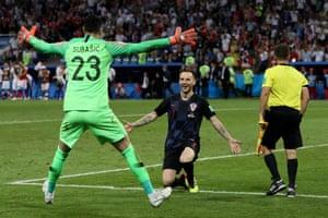 Ivan Rakitic celebrates with Croatia keeper Daniel Subasic of Croatia after he scores his team's fifth penalty, the winning penalty