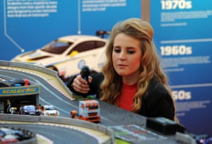 A woman tries out a digital Scalextric set