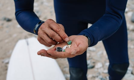 Surfers Against Sewage collect pieces of plastic pollution at Porthtowan Beach, Cornwall.