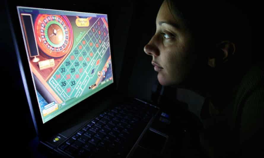 Woman gambling on laptop