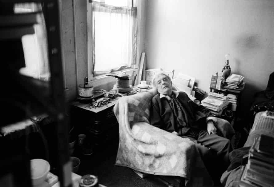 Quentin Crisp in his apartment by Graham MacIndoe.