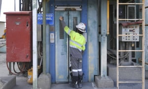 Workers try to open the door of an elevator with Australian Prime Minister Scott Morrison temporarily stuck inside due to a door failure during a visit to South32 Cannington Mine in McKinlay, QLD, Wednesday, January 20, 2021. (AAP Image/Lukas Coch)