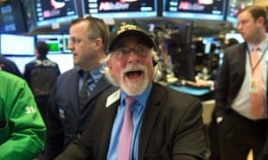 A trader reacts as the Dow Jones closes above 20,000 for the first time at the New York Stock Exchange  last week.