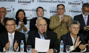 Jesus Torrealba, secretary of Venezuela's coalition of opposition parties (MUD), talks to the media next to Henry Ramos Allup, president of the National Assembly, and their fellow politicians during a news conference in CaracasJesus Torrealba (C), secretary of Venezuela's coalition of opposition parties (MUD), talks to the media next to Henry Ramos Allup (R), President of the National Assembly, and their fellow politicians during a news conference in Caracas March 8, 2016. REUTERS/Carlos Garcia Rawlins