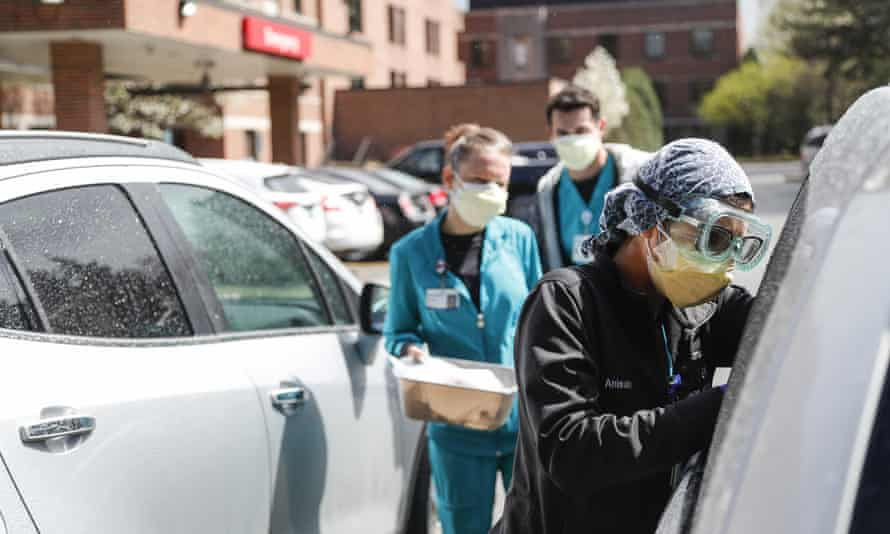Hospital workers test patients for Covid-19 outside of the emergency entrance of Beaumont hospital in Grosse Pointe, Michigan.