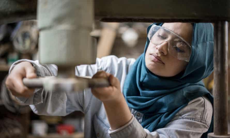 A Muslim woman in a factory
