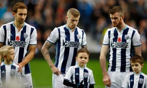 James McClean, centre, without a poppy.