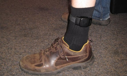 A person with an electronic tag fitted to their leg.