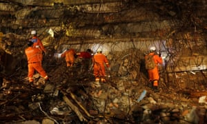 A rescue team searches for missing workers at the site.
