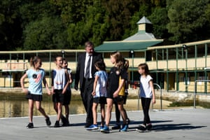 Shadow Minister for Transport and Infrastructure, Anthony Albanese, talks to children from the Balmain water polo and swimming club.