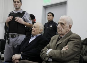 Former Argentinian junta president Reynaldo Bignone (right) and former general Santiago Riveros (centre) at their trial for crimes against humanity in 2012.
