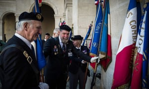 Harki veterans at a ceremony at Les Invalides in Paris to mark the national day of homage to the Harkis