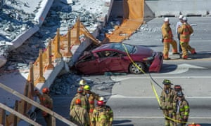 Miami, USEmergency personnel work on a collapsed pedestrian bridge at Florida International University. The structure came down crushing several cars on a state highway and injuring several people.