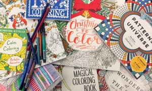 This Dec. 8, 2015 photo shows a display of adult coloring books and markers in New York. (AP Photo/Beth J. Harpaz)