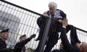 Air France executive Pierre Plissonnier is helped to escape angry staff by police.