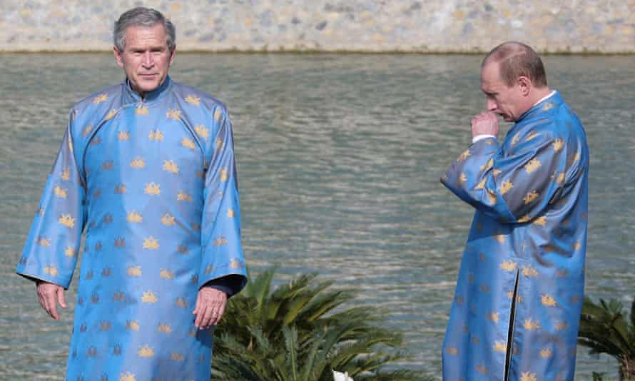 Former US president George W Bush and Russian leader Vladimir Putin look less than comfortable in the Vietnamese 'ao dai' silk tunic at the Apec meeting in Hanoi in 2006.