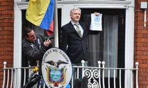 Julian Assange addresses the media outside the Ecuadorian embassy