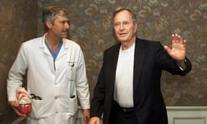 Former president George HW Bush waves as he leaves Methodist hospital with his cardiologist, Mark Hausknecht. Joseph James Pappas, the man suspected of killing the Hausknecht, shot himself during a confrontation with police Friday.
