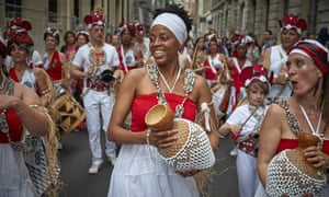A Brazilian street band plays in the Marais Quarter as Parisians celebrate the first day of summer with Fete de La Musique on Sunday