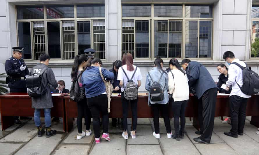 People register to attend the court session for China's first same-sex marriage case.